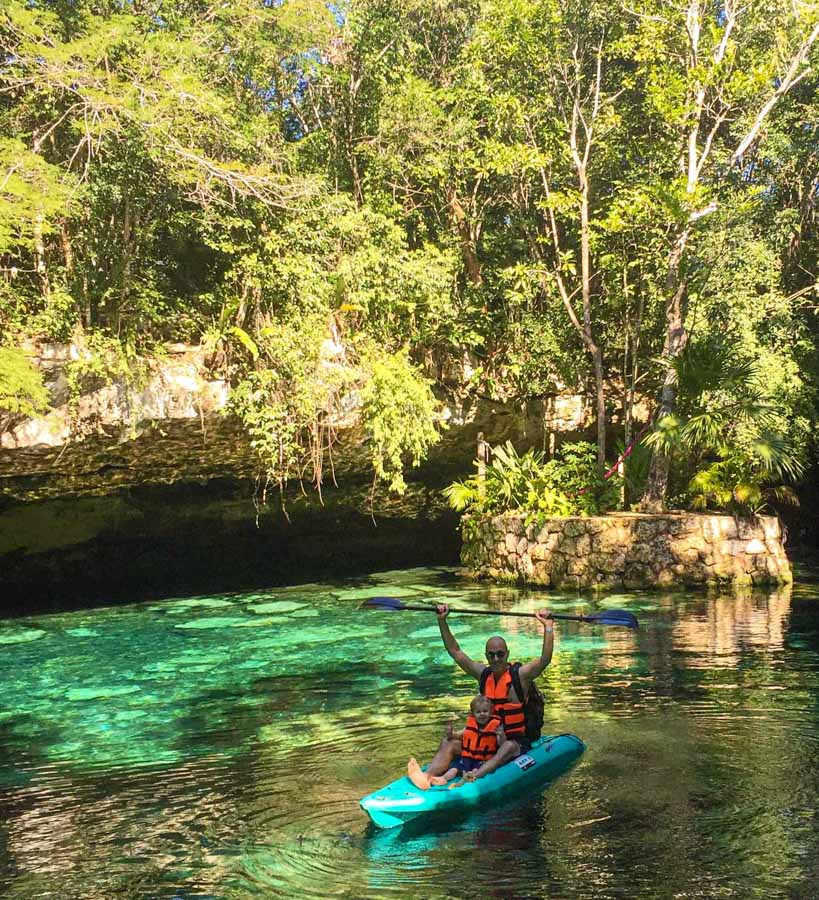 Kayaking on the crystal clear cenote waters at Kantun Chi eco park, Mexico