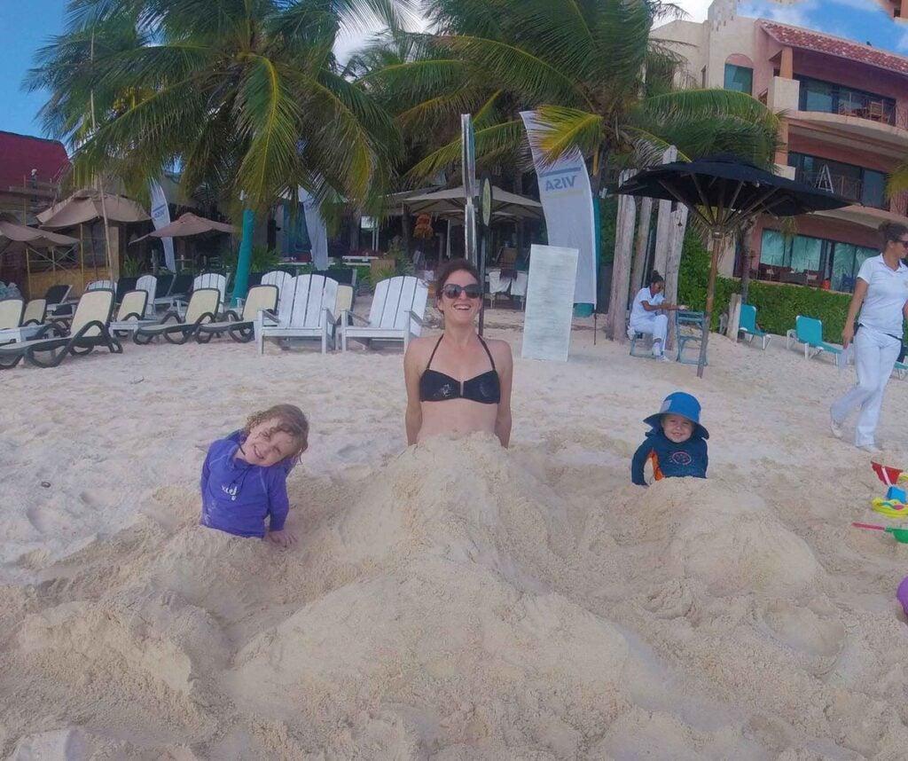 A family of sand mermaids on a Playa del Carmen public beach near Calle 4