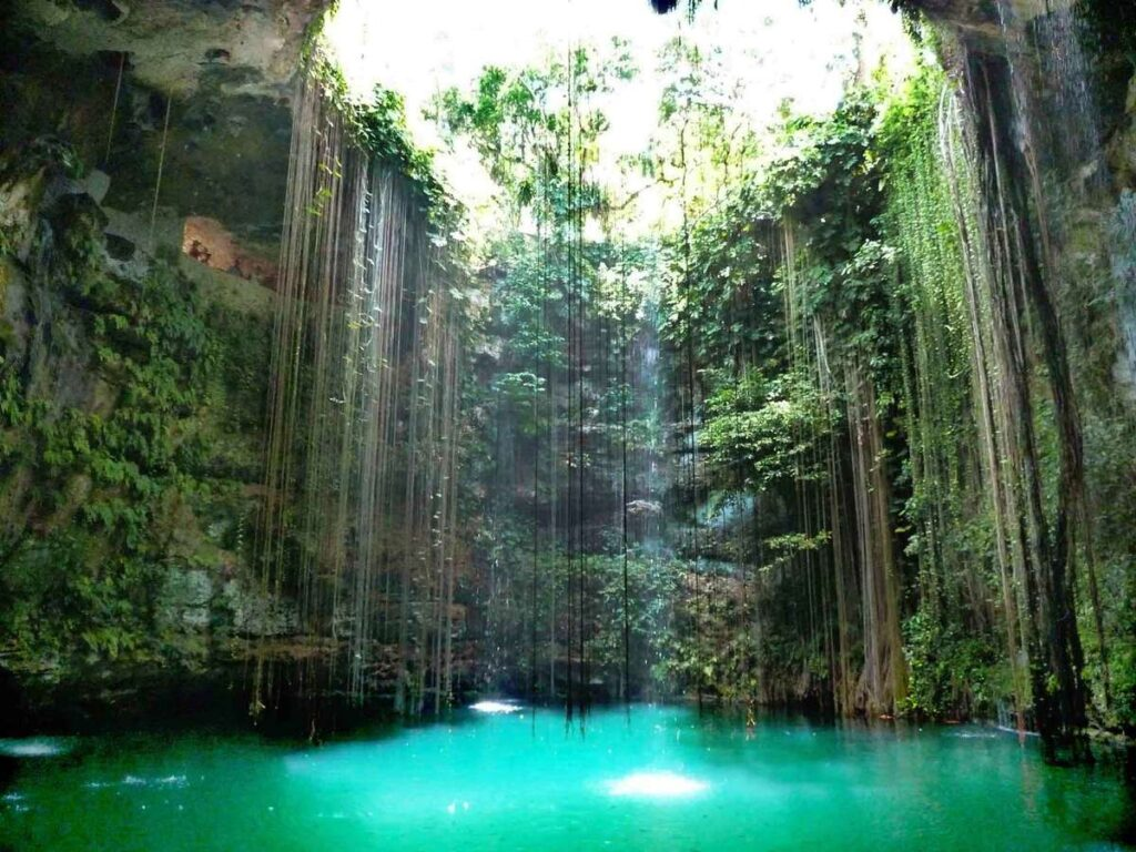 A visit to the incredible Ik-Kil cenote is a popular stop on Chichen Itza day trips