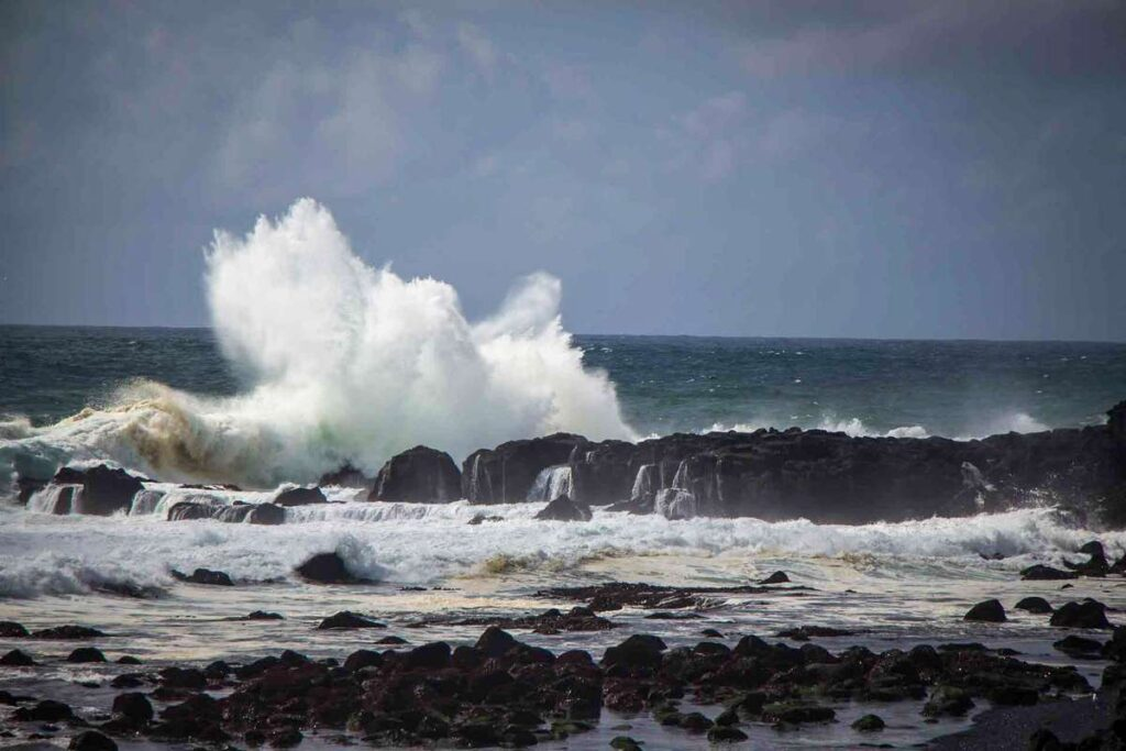 things to do on the Snaefellsnes Peninsula with kids - watch waves crash at Londrangar Cliffs near Malariff Lighthouse