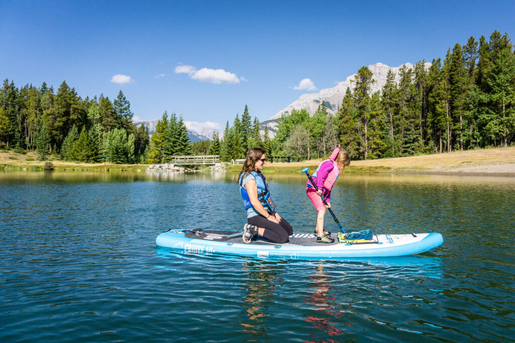Stand Up Paddle Boarding on Johnson Lake in Summer in Banff with Kids