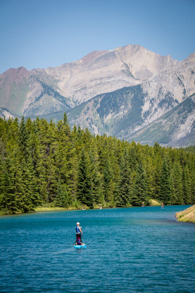 Stand Up Paddle Boarding on Two Jack Lake in Banff with kids