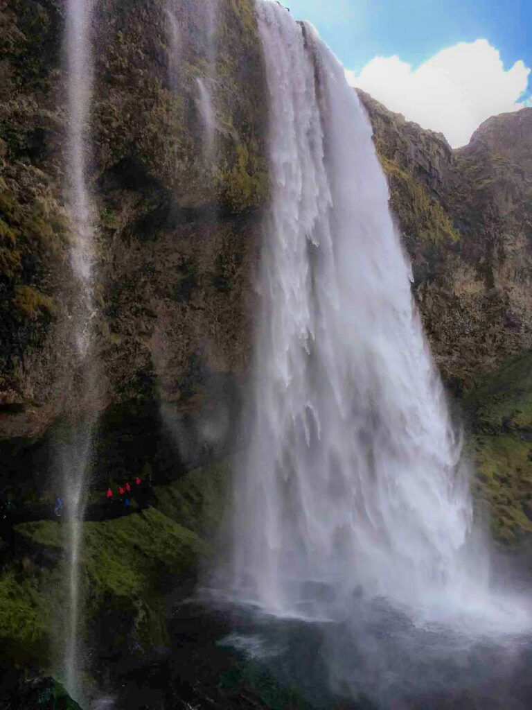 things to do in iceland with kids - Walking behind the Seljalandsfoss Waterfall in South Iceland