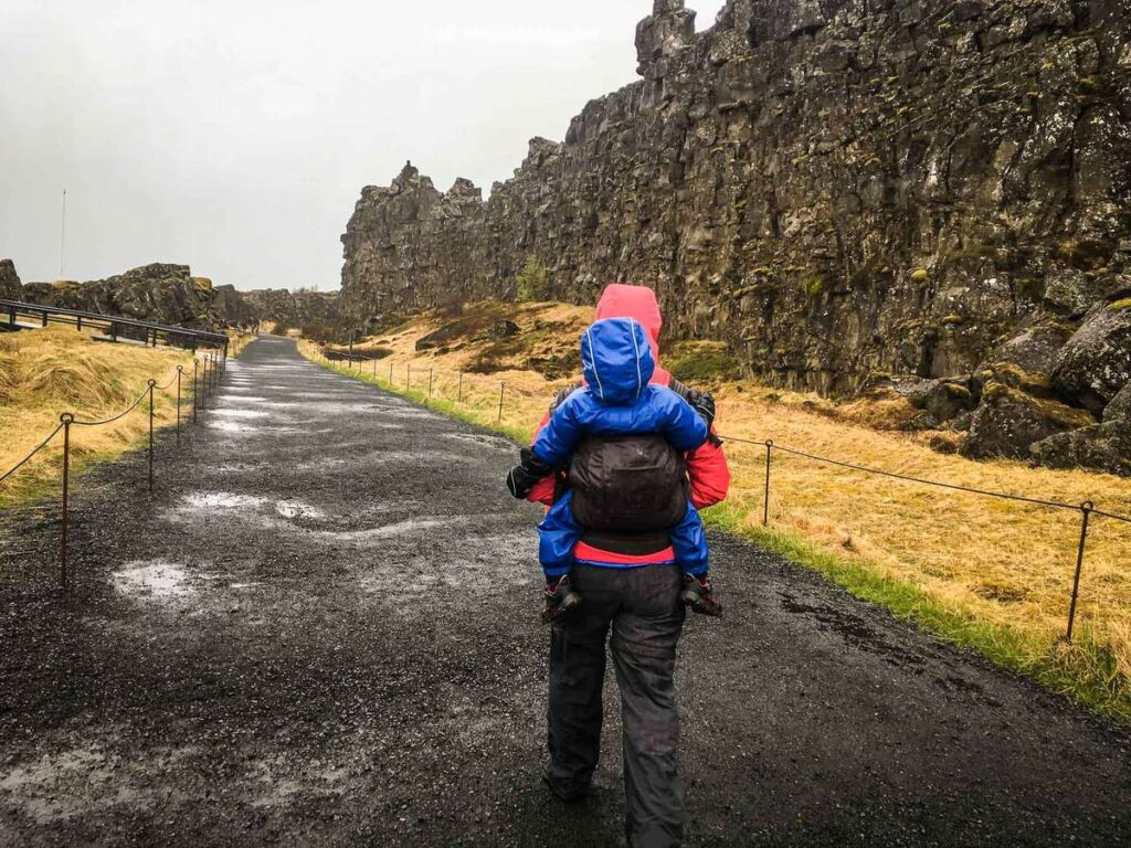 what to bring on family trip to iceland with kids - using a toddler carrier at the Thingsvellir National Park in the Golden Circle