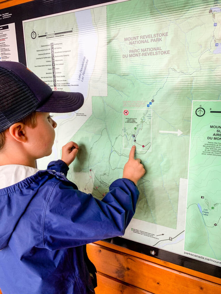 hiking in Revelstoke with kids - looking at a map of hiking trails in Mount Revelstoke National Park