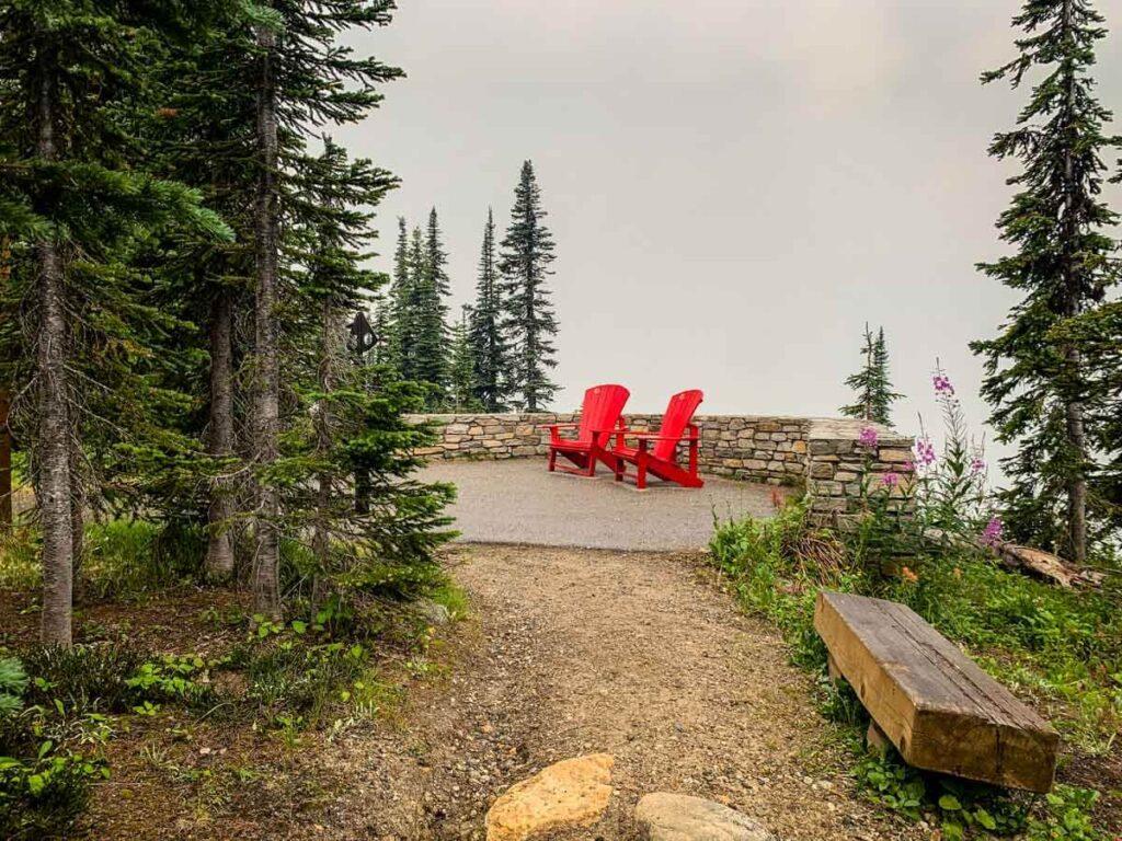 easy revelstoke hiking - red adirondack chairs on the kid-friendly Koo Koo Sint Trail