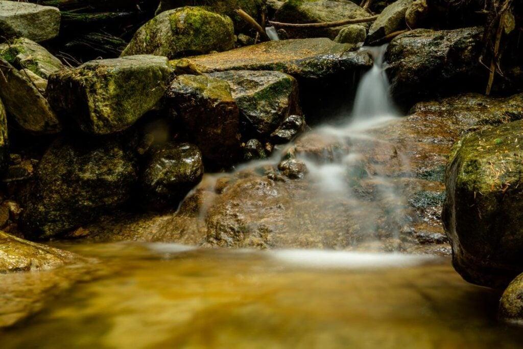 easy Revelstoke hiking in Mount Revelstoke National Park - small waterfall on Broken Bridge Trail