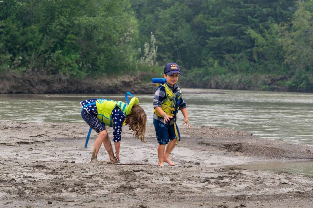 Our kids loved playing in the mud on the shores of the Columbia River while canoeing from Invermere to Radium